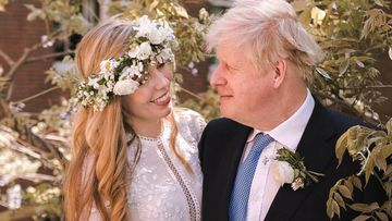 (FILE PHOTO) Prime Minister Boris Johnson And Carrie Johnson Are Expecting Their Second Child. LONDON, UNITED KINGDOM - MAY 29: (Alternate crop of #1233183330)  In this handout image released by 10 Downing Street, Prime Minister Boris Johnson poses with his wife Carrie Johnson in the garden of 10 Downing Street following their wedding at Westminster Cathedral, May 29, 2021 in London, England. The secretly planned wedding took place in a small ceremony on Saturday afternoon. Johnson is the first Prime Minister to get married while in office in nearly 200 years. (Photo by Rebecca Fulton / Downing Street via Getty Images)