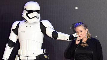 FA0023. London (United Kingdom), .- (FILE) - A file picture dated 16 December 2015 shows US actress/cast member Carrie Fisher posing next to a Stormtrooper film character as she arrives to the European premiere of the film 'Star Wars: The Force Awakens' in Leicester square in London, Britain. According to media reports on 23 December 2016, Carrie Fisher has been hospitalized due to a heart attack. (Londres, Atentado, Cine, Estados Unidos) EFE/EPA/FACUNDO ARRIZABALAGA *** Local Caption *** 53067674